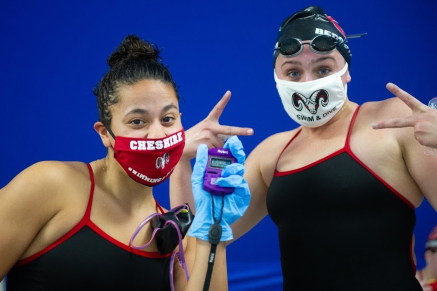 From left, senior swimmers Bella Tejeda and Nora Bergstrom wear masks at the Cheshire Community Pool. Photo courtesy of the Glover