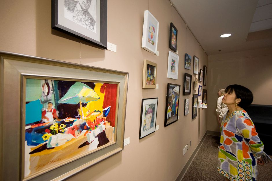 File photo - Artists admire the work of their peers at an Artsplace exhibit in 2018.