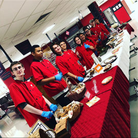 Cheshire students line up to serve food at a catering activities. Photo courtesy of Eileen Wildermann.