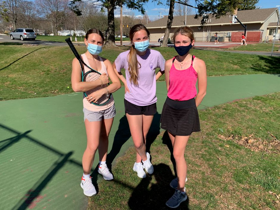 From left, senior tri-captains Ellie Rockoff, Alyssa Behuniak, and Kate Koval have assumed leadership roles on and off the tennis court this spring. Photo taken by Greg Lederer/Cheshire Herald.