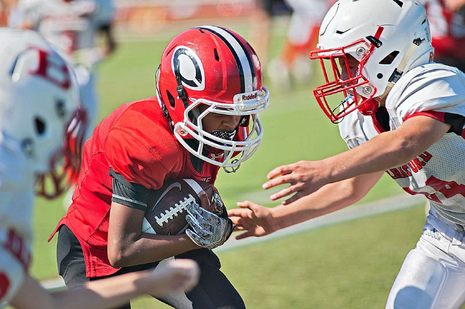 CJF fifth grader Chris Pangaro carries the ball at Cheshire High School. Photo taken by Al Valerio/Cheshire Herald.