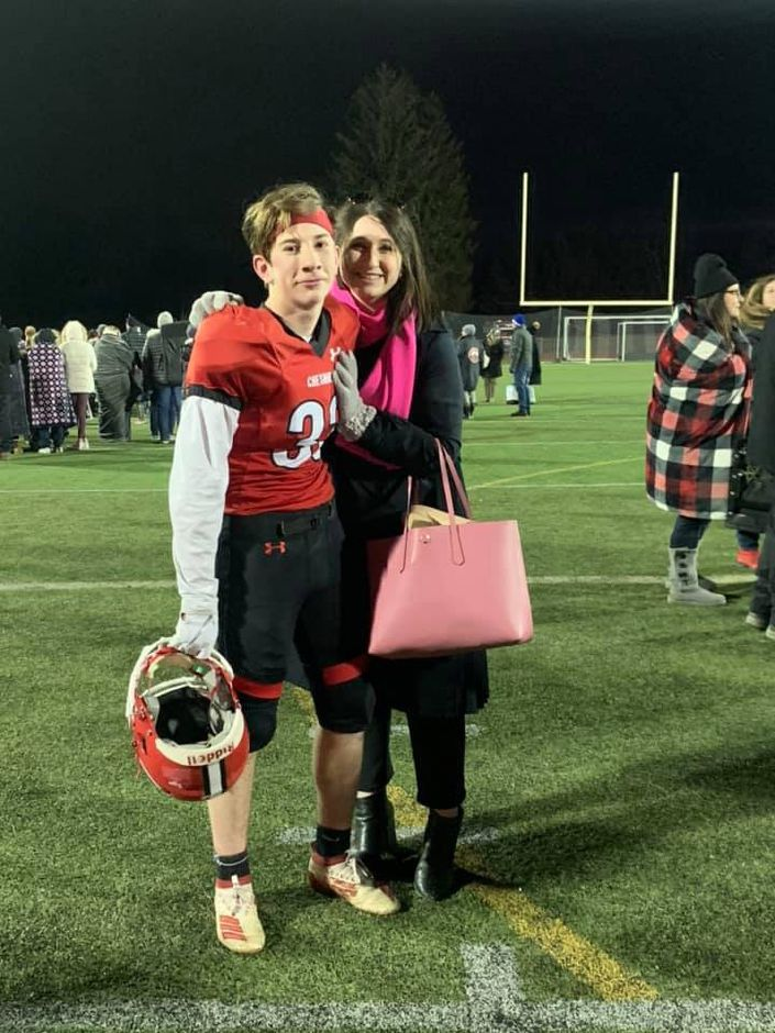 CJF eighth grader Adam Vernon poses with her older sister Alea after the SYFC title game. A 2018 CHS graduate, Vernon sang the National Anthem before the contest. Submitted photo.