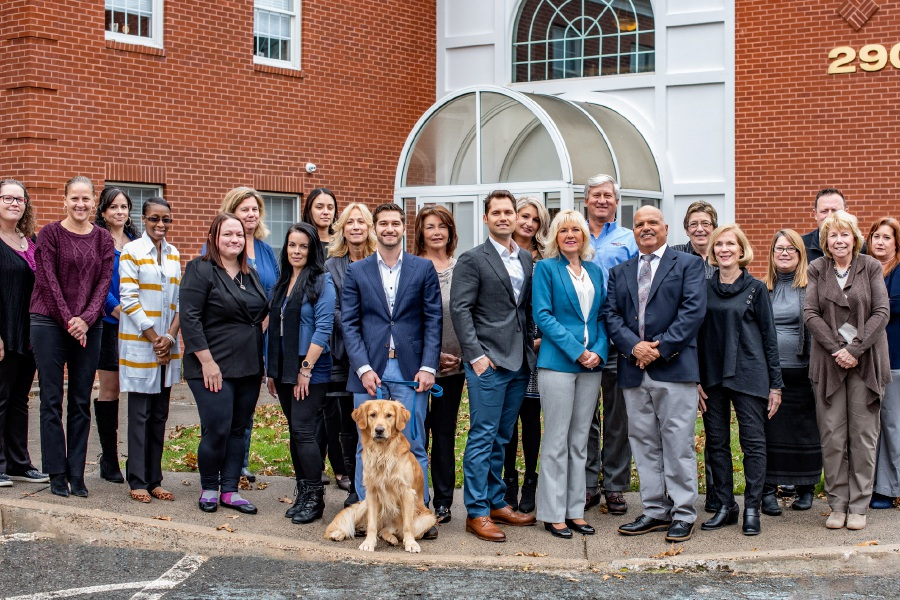 Mario D'Aquila (above) is the chief operating officer of Assisted Living Services. The office staff of the home health care agency is pictured at left in front of the company's Cheshire headquarters.