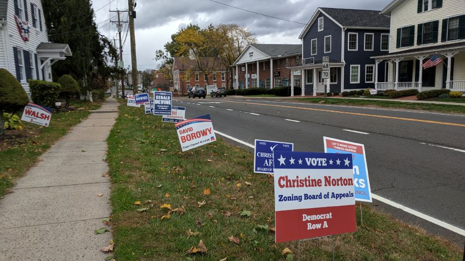 Campaign signs line the grass along Main Street Thursday afternoon.