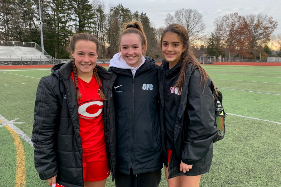 From left, Marisa Brough, Caroline Campion and Ella Crerar shared an emotional moment following the CHS girls' soccer game against New Canaan. Photo taken by Greg Lederer/Cheshire Herald.