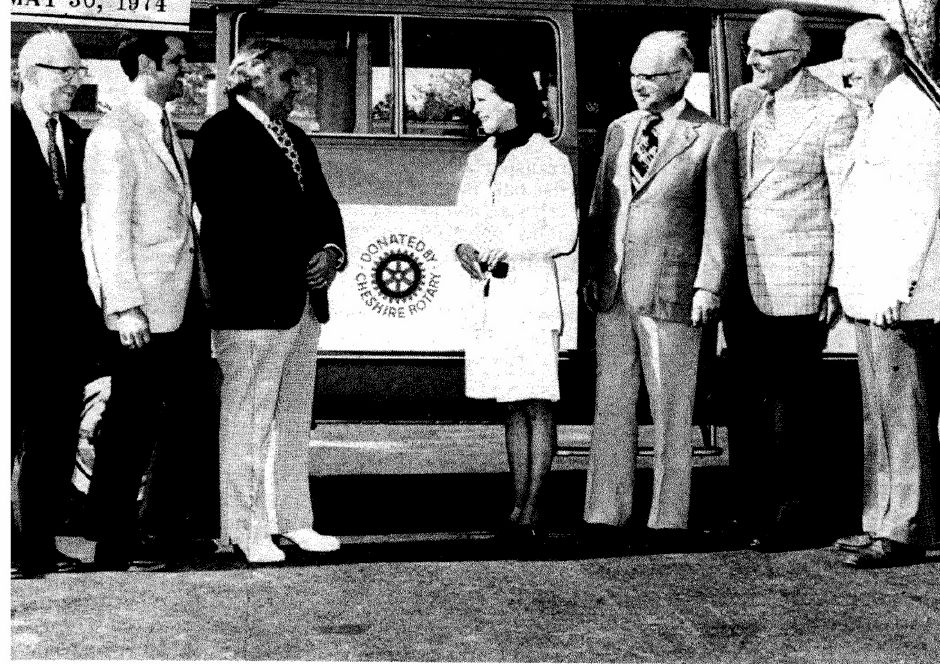 Shown with the new senior citizen jitney bus are, left to right, William Felske, chairman of the Senor Day Center's Board of Directors; Richard Ulbrich, president of Rotary Club; C. William Ardolino, president of Terry Chevrolet; Mrs. Selina McArdle, municipal agent for services to retired persons; Richard Miller; chairman of the Rotary bus committee; Frank Washburn , chairman of the Committee on Aging, and Russell Smith, chairman of the COA transportation sub-committee.