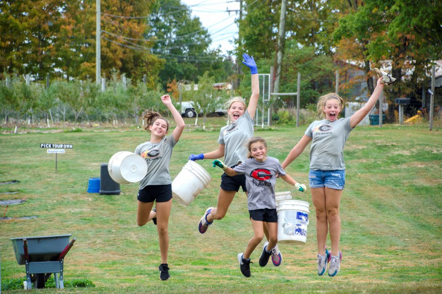 From left, Addison Coffey, Jaze Ribeiro, Avery Miramant, and Molly Fleming had fun volunteering at Old Bishop Farms.