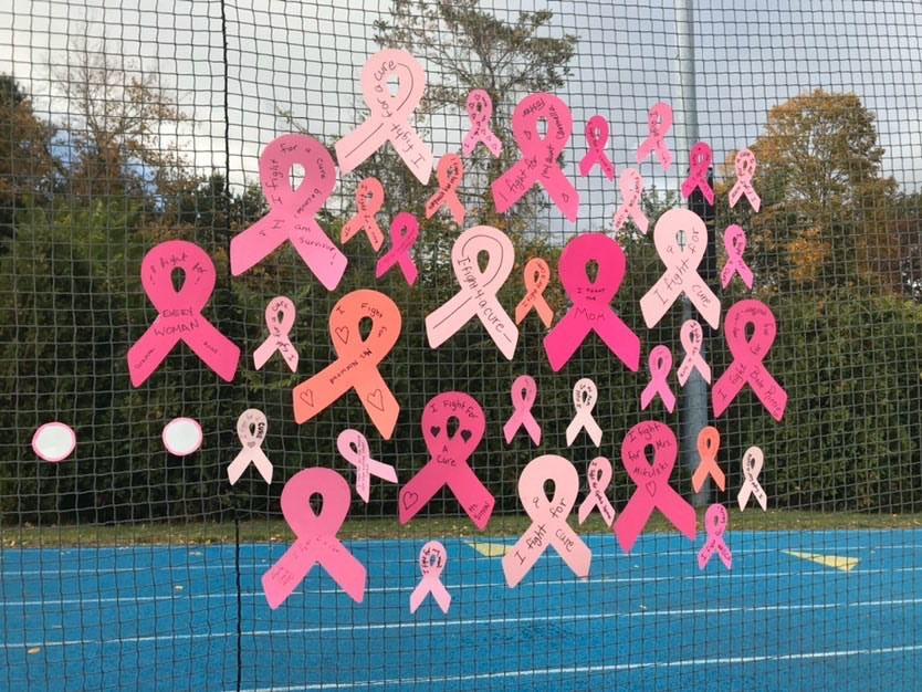 Cheshire Academy field hockey cut out breast cancer ribbons and hung them on the netting at Simosa Field. Photo courtesy of Riley Norwood.