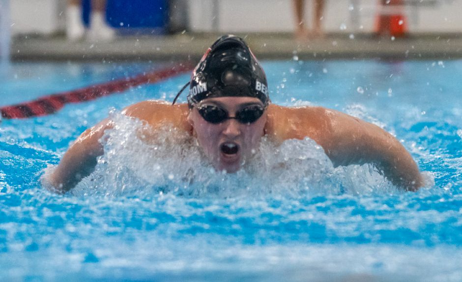 Nora Bergstrom comes up for a breath during her victory in the 100-yard butterfly. Photo taken by Aaron Flaum/Record-Journal.