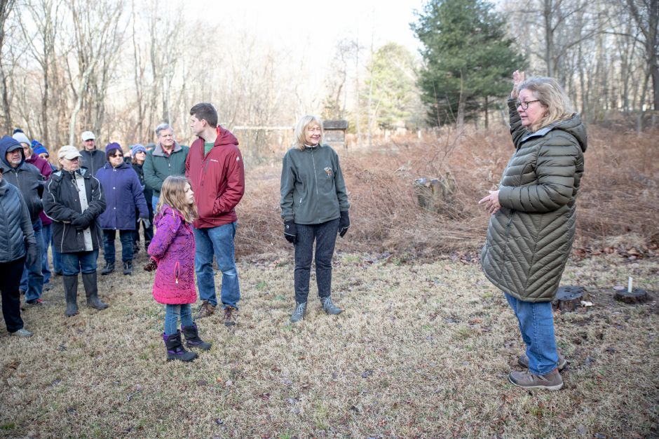 Devin Leith-Yessian/Record-Journal – Joy VanderLek, right, speaks with hikers in one of the garden at the Riverbound Farm Sanctuary in Cheshire. President of the Cheshire Land Trust, VanderLek helped members of the Quinnipiac Valley Audubon Society lead First Day Hike around the property on Jan. 1.