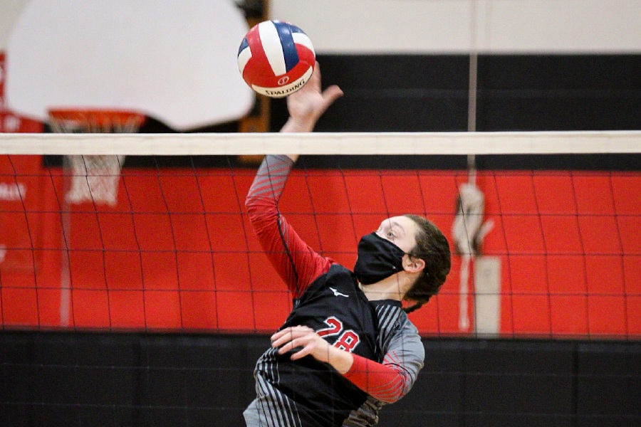 Hannah Portal puts down a kill at the net. Photo taken by James Brandolini/Cheshire Herald.
