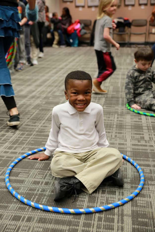 Tracey Harrington/Cheshire Herald - Jaxson Bogues was excited to get things swinging at the Hula Hoop event on Friday, Jan. 24, at the Cheshire Public Library.