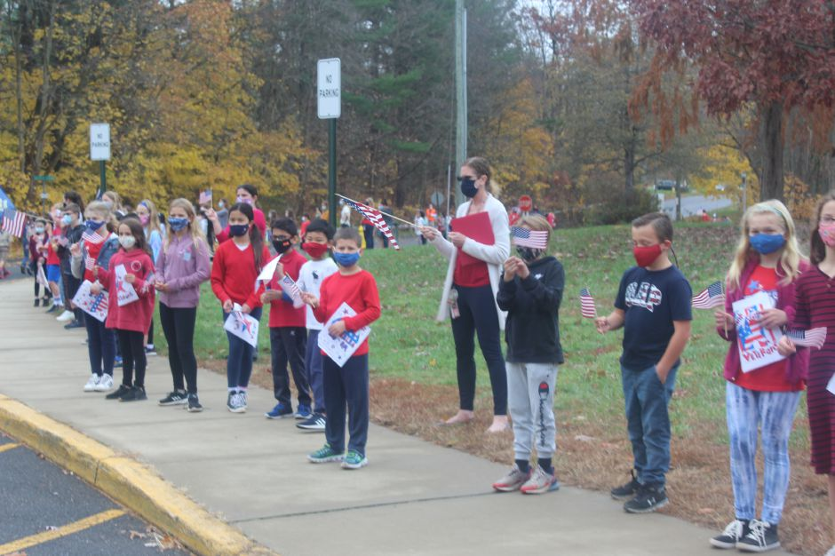 Mariah Melendez/Cheshire Herald- Students lined the Highland Elemenary School parking lot for the Veterans Day walking parade.