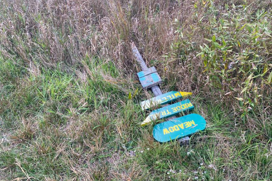 Photo courtesy of Joy Vanderlek – A broken trail signs at Fresh Meadows wildlife sanctuary.