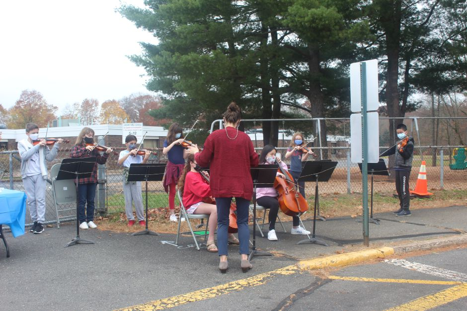 "Mariah Melendez/Cheshire Herald- Highland Orchestra conducted by Marlane Fitzgerald performed the ""Star-Spangled Banner"" for the crowd."