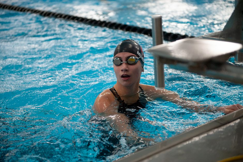 Sophie Murphy reacts after finishing her Cheshire career with a third program record in the 100-yard freestyle (50.86). She set the mark on the opening leg of the 400-yard freestyle relay that CHS won in 3:34.26. Photo courtesy of Gale Glover.