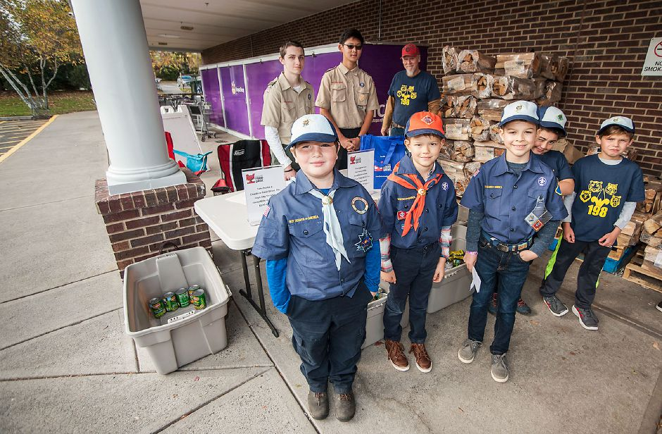 Al Valerio/Cheshire Herald - BSA Cub Scout Pack 198 (foreground) and Boy Scout Troop 198 (background) Scouts collected donations in front of Stop and Shop on Sunday.