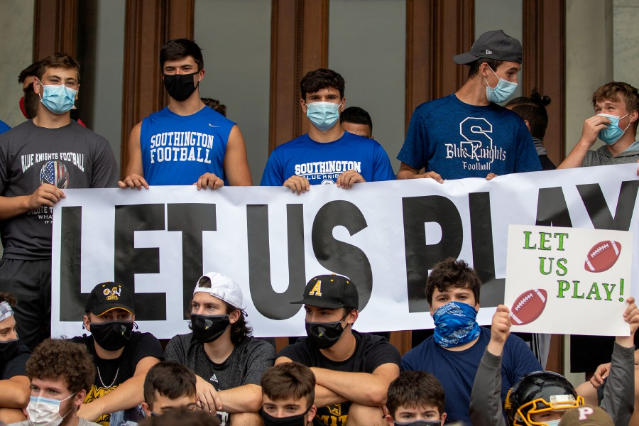 Southington high school football players hold a sign as they gathered for a rally at the Connecticut State Capitol during a rally trying to reinstate a football season on Wednesday, September 9, 2020. Aaron Flaum, Record-Journal