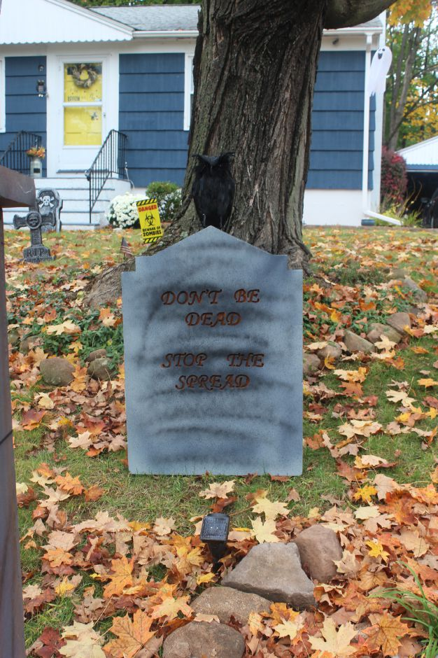 "Mariah Melendez/Cheshire Herald- Tombstone made by Pactrick Woodward outside his home at the ""Avon Boulevard Cemetery"". Tombstone reads ""Don't Be Dead, Stop The Spread"" to encourage visitors to social distance when visiting the display."