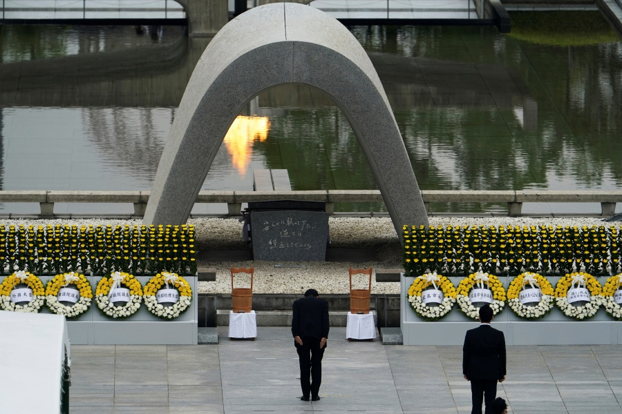 Japanese Prime Minister Shinzo Abe bows in front of Hiroshima Memorial Cenotaph during a ceremony to mark the 75th anniversary of the bombing at the Hiroshima Peace Memorial Park Thursday, Aug. 6, 2020, in Hiroshima, western Japan. (AP Photo/Eugene Hoshiko)