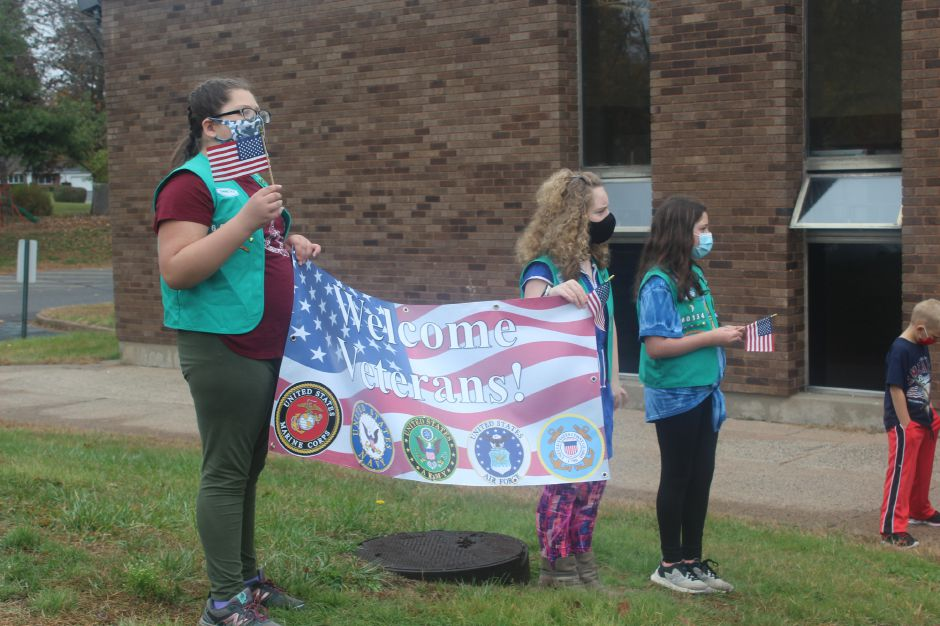 "Mariah Melendez/Cheshire Herald- ""Welcome Veterans"" sign held by Highland Girl Scouts."