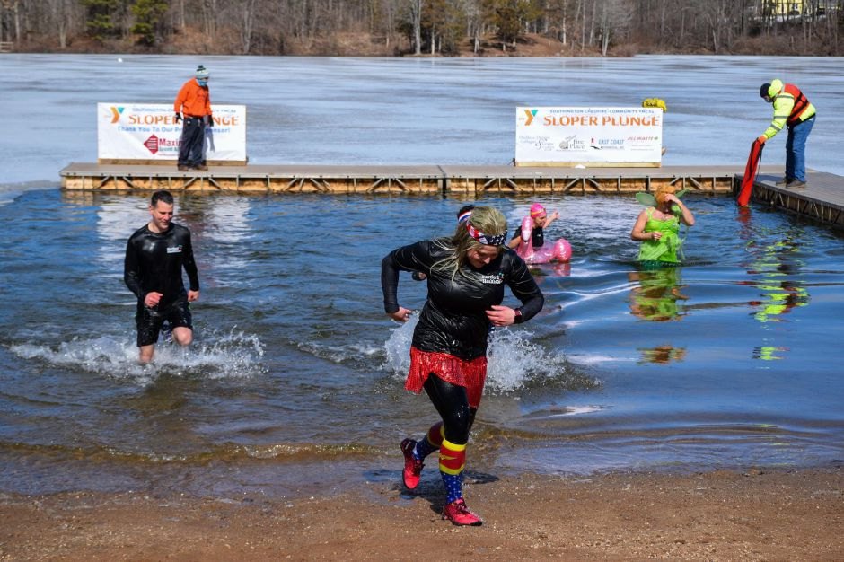 People run out of the water after taking the plunge. Photo courtesy of the Southington-Cheshire Community YMCA.