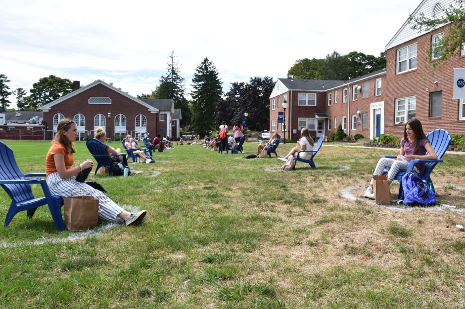 Photo courtesy of Cheshire Academy – Blue chairs are set up around Cheshire Academy's campus in order to provide safe opportunities for outdoor instruction and student interaction.