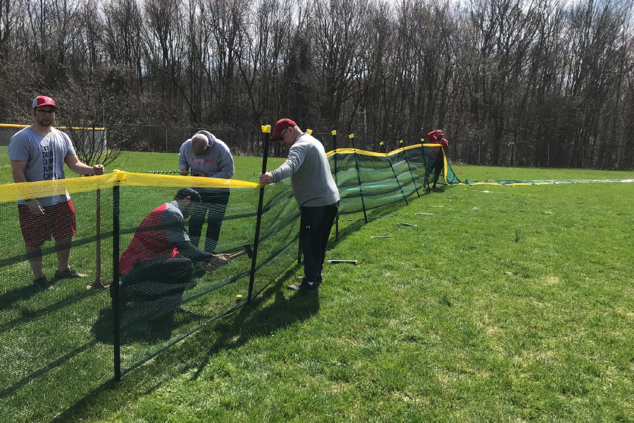 On April 10, Cheshire residents Christopher Enders, Jose Torres, John Melillo, David Feldman, Vito Catalanotto, Mike Calli, and Jerry Jerome came out to MacNamara Legion Field to install a new fence on diamond number four. Photo courtesy of Catalanotto.