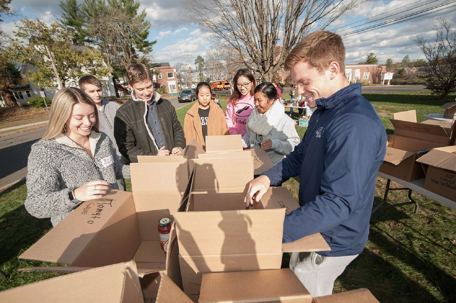 Al Valerio/Cheshire Herald - Volunteers sorted through items as they were placed in boxes during the Cheshire Food Drive.