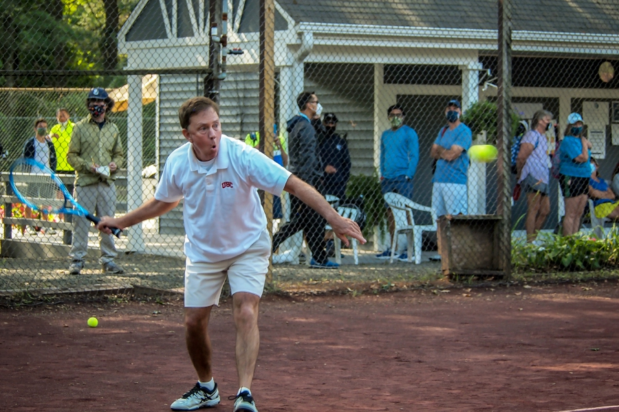On Saturday at Copper Valley Club in Cheshire, Connecticut Governor Ned Lamont focuses on hitting the ball during the Connecticut State Employees Campaign Tennis Tournament. Photo courtesy of Marcy Light.