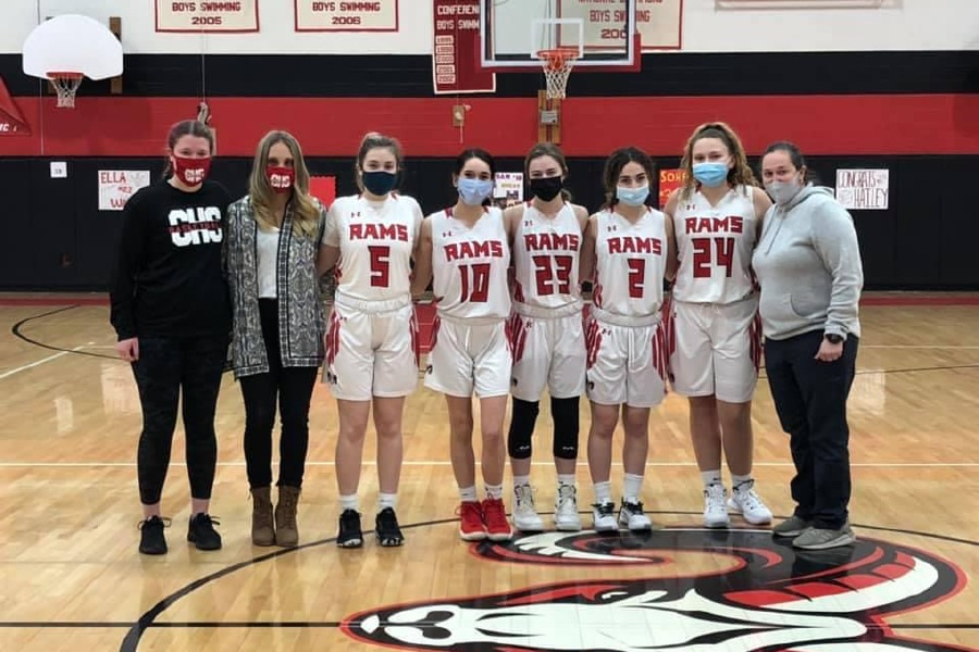 From left, Avery Gress, Head Coach Angelica Ariola, Kaylee Clark, Jordan DeMatteo, Ella Watson, Sophie Vagts, Hailey Beling, and Assistant Amy Gilchrist posed for a photo after CHS girls