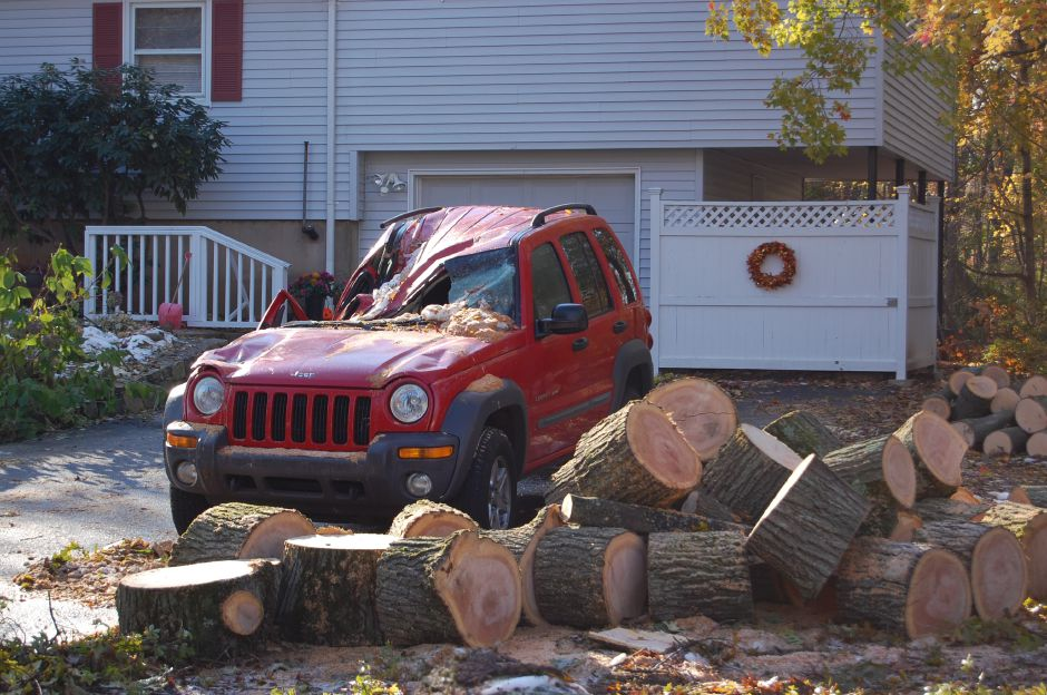 File photo – This Jeep was left flattened by a downed tree during the 2011 October Snowstorm.