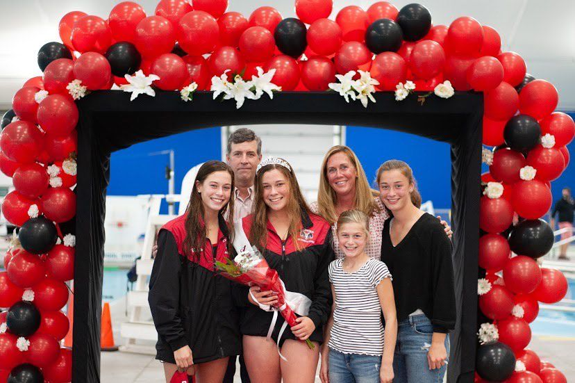 For Senior Night on Oct. 10, girls' swim and dive tri-captain Mary Barto was recognized at the Cheshire Community Pool. Barto is pictured with her father John, mother Molly, and younger sisters Julia, Caroline, and Ellen. Photo courtesy of Gale Glover.
