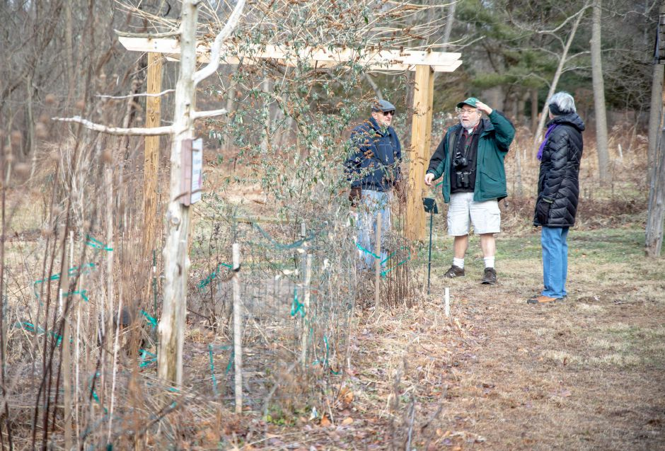 Devin Leith-Yessian/Record-Journal – Eric Eichhorn, center, speaks with hikers in one of the garden at the Riverbound Farm Sanctuary in Cheshire. Eichhorn was one of the members of the Quinnipiac Valley Audubon Society who led a hike around the property for the First Day Hike on Jan. 1.
