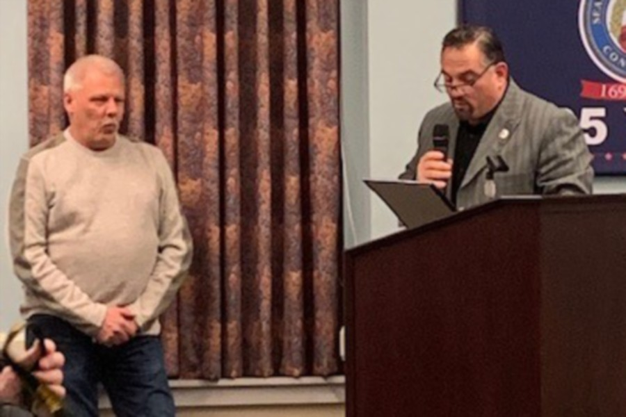 Keith Baron receiving a proclaimation from Chairman Rob Oris at the last Town Council Meeting.