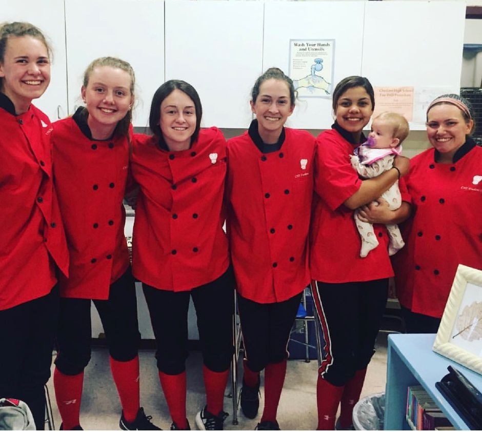 From left, Emma Watkinson, Mia Juodaitis, Ari Perlini, Danielle Floyd, Jade Barnes, and Lexie Hemstock posed during a catering event last year. Photo courtesy of Eileen Wildermann.