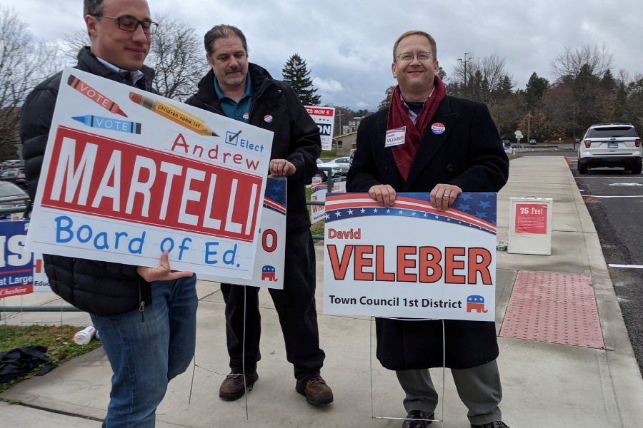 Republican candidates Andrew Martelli, Rob Brucato and David Veleber held signs outside a local polling station during on Election Day, Nov. 5.