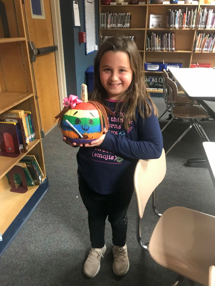 Aria Porto, second grade Chapman student with her painted pumpkin 2019
