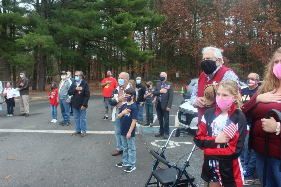 Mariah Melendez/Cheshire Herald- Veterans and their families honor the flag during the Pledge of Allegiance.