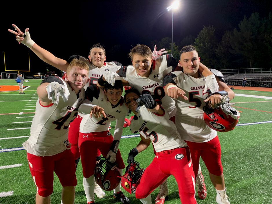 Senior Jake McAlinden, junior Jotham Casey, senior Alec Frione, senior co-captain Will Bergin, junior Cole Feinauer, and senior Sean Cangiano pose after CHS football won at Shelton. Photo taken by Greg Lederer/Cheshire Herald.