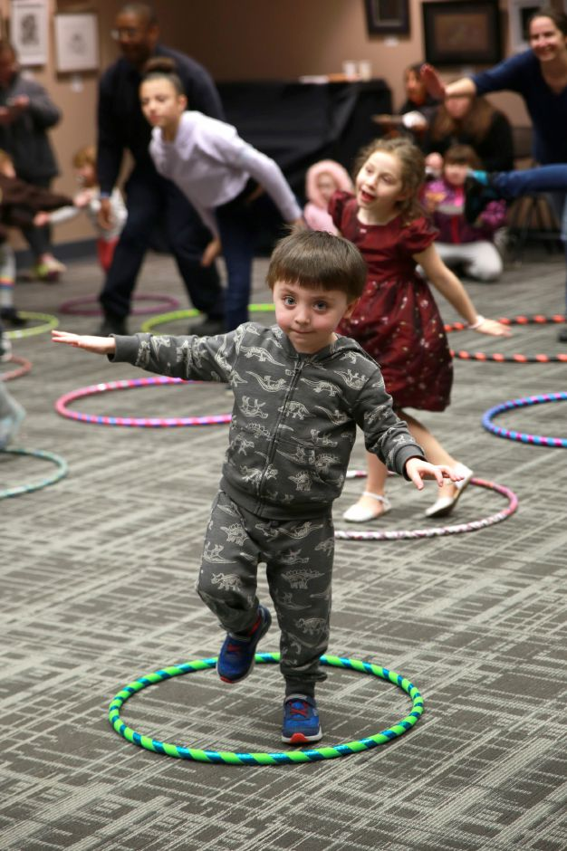 Tracey Harrington/Cheshire Herald - Maxton Caruso did his best to balance himself during the Hula Hoop event on Friday, Jan. 24, at the Cheshire Library.