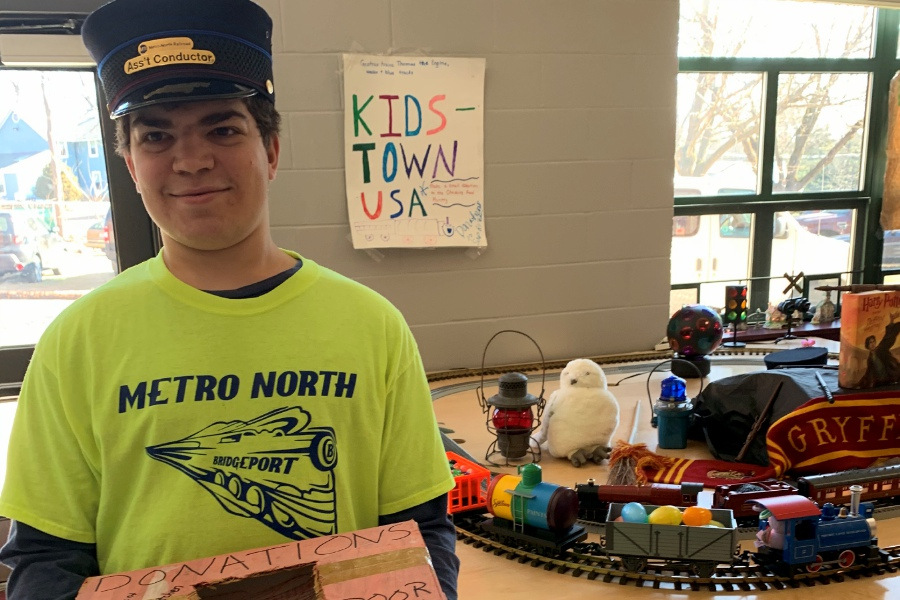 "Justin Gentile, 18, at his exhibit entitled ""Kidstown, USA"" at the Cheshire Train Show. Photos courtesy of Kim & Steve Gentile"