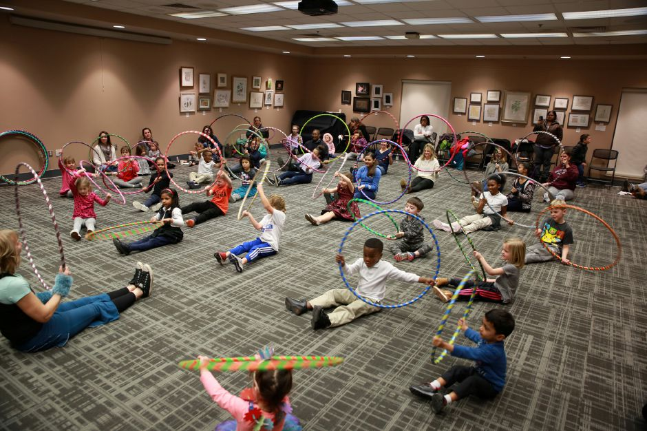 Tracey Harrington/Cheshire Herald - There were plenty of hula hoops to go around at the Cheshire Library on Friday, Jan. 24.