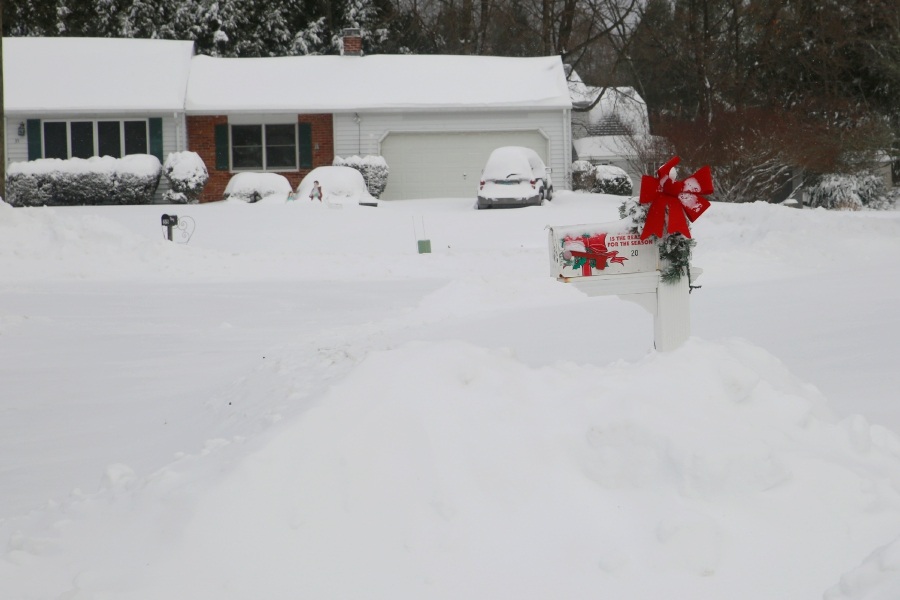 Tracey Harrington/Cheshire Herald - The cleanup in Cheshire began on Thursday afternoon and continued into Friday, after the first major snowstorm of the year left approximately a foot of snow in its wake.