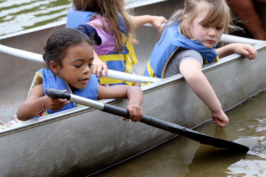 Aaron Flaum/Record-Journal Staff – Camper Olivia Berry, 5, (left) tries to paddle as Brooklyn Grenie,r 4, watches during a canoe trip on Slopers Pond at the Southington-Cheshire YMCA Camp Sloper in Southington on Tuesday Aug. 13, 2019.