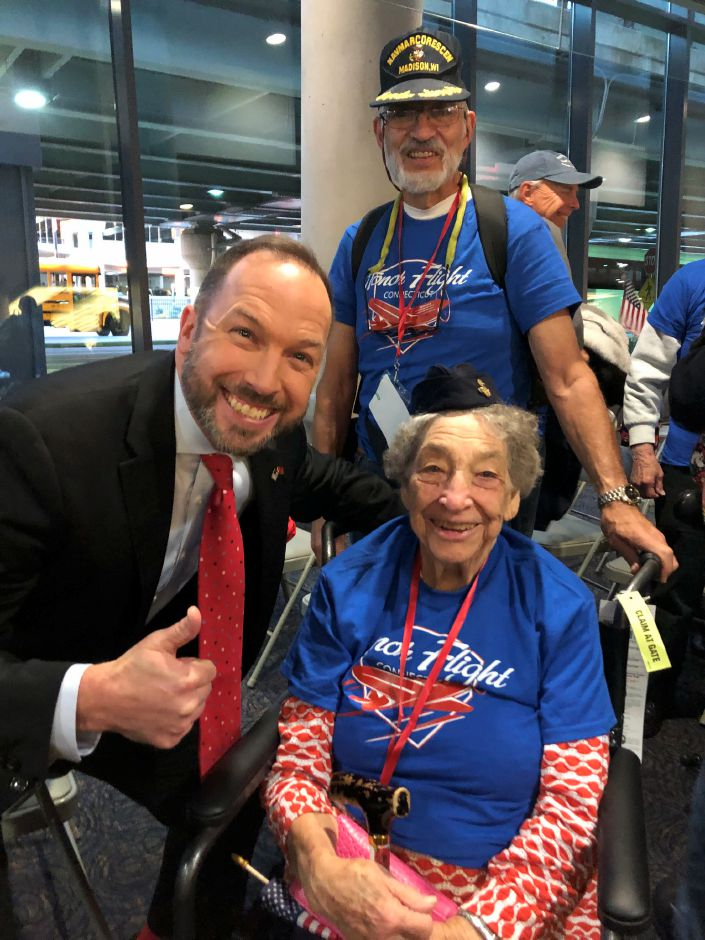 Submitted photo – WTNH meteorologist Gil Simmons greets Nora Adams at Bradley International Airport.