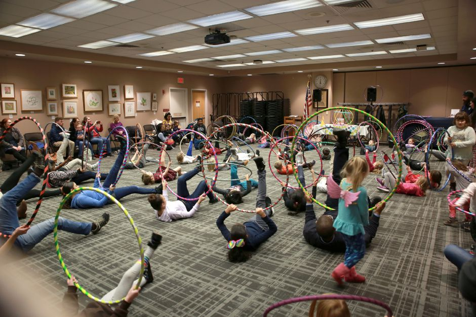 Tracey Harrington/Cheshire Herald - Children spent their Friday evening on Jan. 24 at the Cheshire Library learning how to hula.