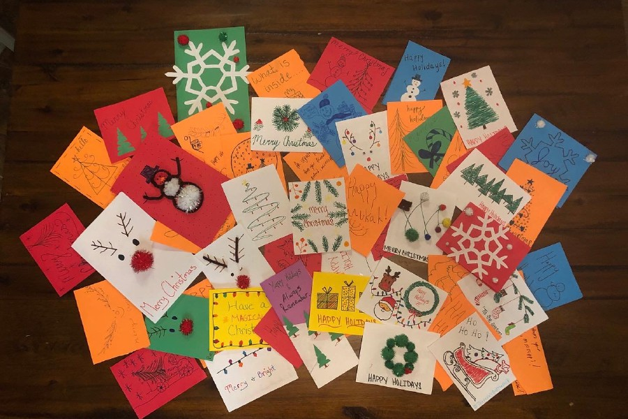 In Oxford, Mississippi, CHS graduates Taylor Strange and Stephen Carlette made holiday cards with their friends. Strange will deliver all the cards to St. Jude Children's Research Hospital in Memphis, Tennessee.