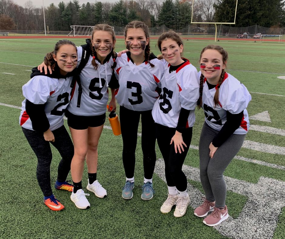 From left, juniors Jaelynn Cafourek, Ellie Rockoff, Julia DePalma, Sophia Kuhlthau, and Sophie Braylyan posed after playing in their first CHS Powder Puff game. Photo taken by Greg Lederer/Cheshire Herald.