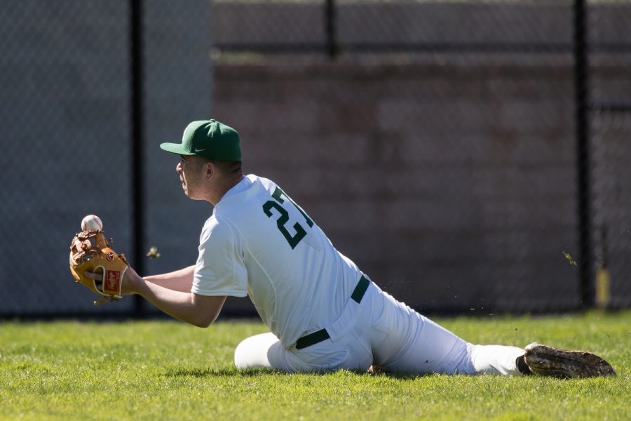 File photo – Meriden's Owen Papciak dives for a shallow hit ball during a high school game last year.
